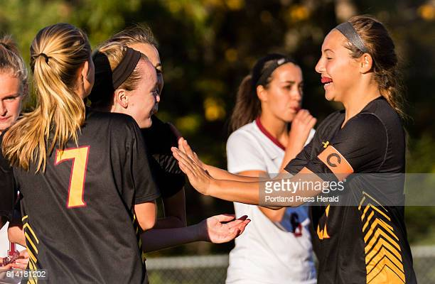 Cape Elizabeths Tory McGrath is congratulated by teammatesKarli Chapin and Bridget Brett after scoring the first goal against Freeport in varsity...