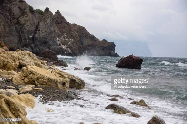 cape fiolent, storm at the beach, crimea - argenberg stock pictures, royalty-free photos & images