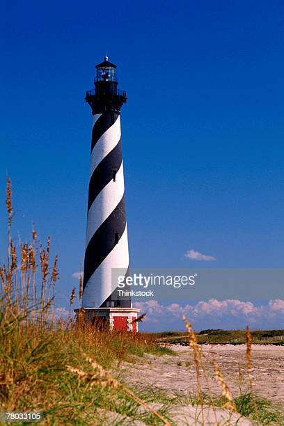 cape hatteras lighthouse on the beach of north carolina. - cape hatteras stock pictures, royalty-free photos & images