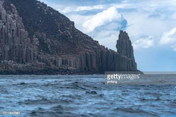 cape hauy, eaglehawk neck coastal cliff view on tasman national park conservation area, port arthur, tasmania - escarpment stock pictures, royalty-free photos & images