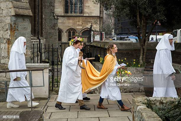A cape is held as members of The Druid Order walk in procession towards Tower Hill to celebrate the Spring Equinox on March 20 2015 in London England...