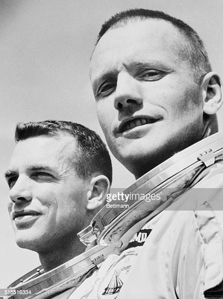 Astronauts Neil Armstrong and David Scott are shown during brief picture session here as they continued preparations for March 15 Gemini 8 mission
