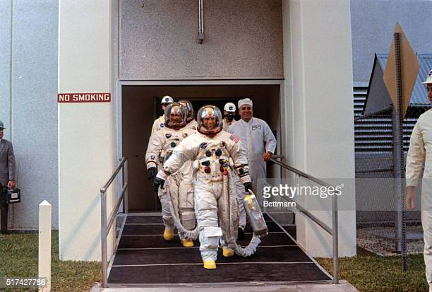 After suiting up Apollo 12 astronauts head for transfer van for trip to Launch Complex 39A and their blastoff for the moon November 14th Charles...