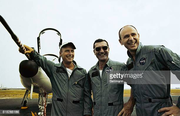 Apollo 12 astronauts Charles Conrad Richard Gordon and Alan Bean hold a short news conference following the joint 'relaxation flight' in T38 jet...
