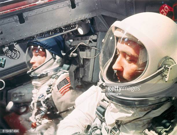 Seated in their Gemini 4 capsule are Maj McDivitt right and Maj Edward White