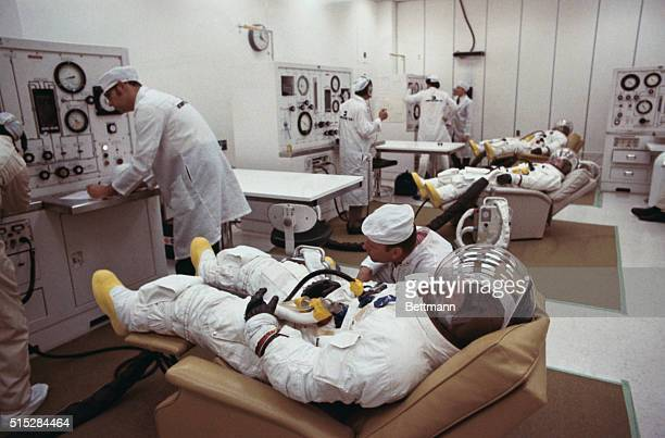 Suited for their moon trip Apollo 12 astronauts Charles Conrad Commander Richard Gordon Command Module Pilot and Alan L Bean Lunar Module Pilot lie...