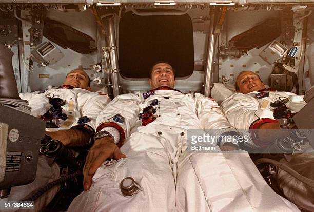 Apollo 12 astronauts lie inside the command module during preparations for the November 14th blastoff Left to right Alan Bean lunar module pilot...