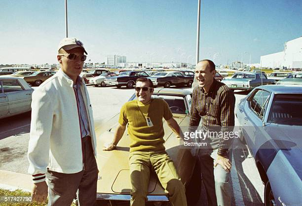 Apollo 12 astronauts relax in the Florida sunshine a few days before blasting off on the moon mission Left to right Charles Conrad Commander Richard...