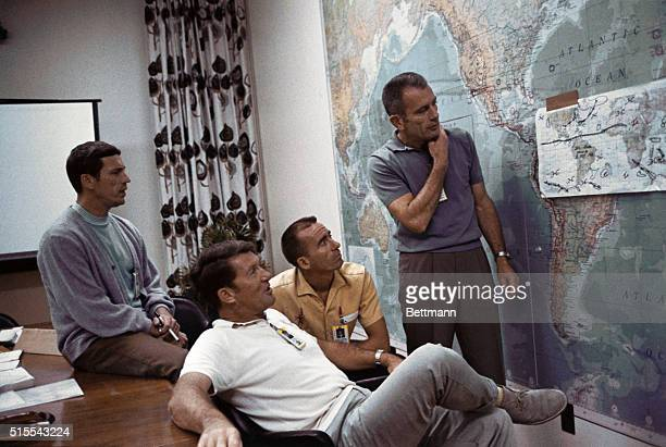 Members of the Apollo 7 crew LR Donn F Eisele Walter Schirra Jr and Walter Cunningham enjoy a light moment with Deke Slayton Director of Flight Crew...