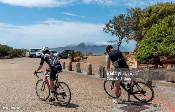 Cape Point, Table Mountain National Park, South Africa, Cyclists set off from the Cape Point parking area on a cycle ride through the Table Mountain...