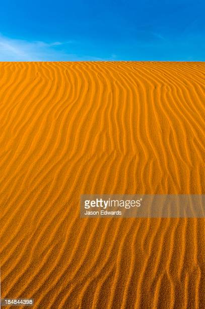 geometric ripples in the face of a red sand dune in a coastal desert. - international landmark stock pictures, royalty-free photos & images