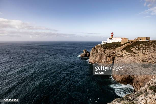 cape san vicente lighthouse algarve portugal - faro stock photos and pictures