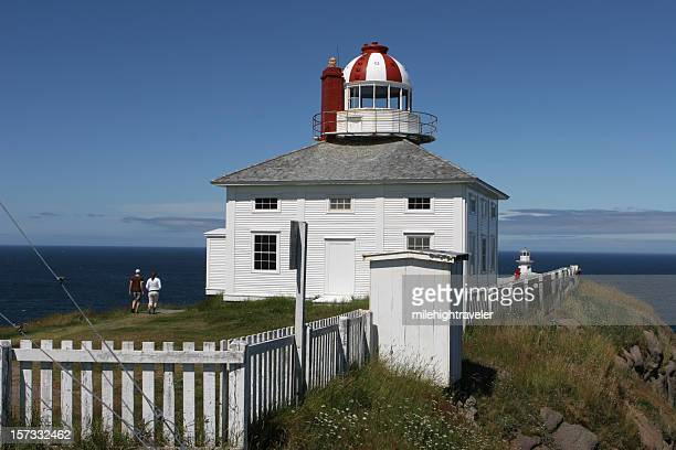 cape spear lighthouse and white picket fence, newfoundland - st. john's newfoundland stock photos and pictures