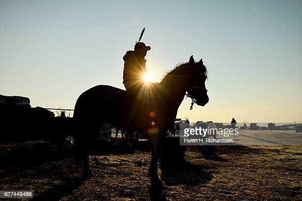 Cape Teal of the Cheyenne River Sioux nation gets ready to head out for a ride on his horse Sasha at Oceti Sakowin Camp on the edge of the Standing...