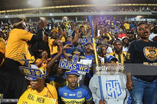 Cape Town City's supporters cheer for their team during the Premier Soccer League football match between Cape Town City and Mamelodi Sundowns at Cape...