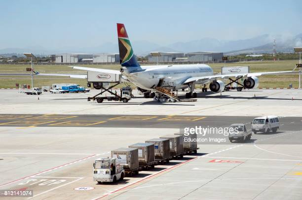Cape Town International Airport South Africa South African Airways A340600 passenger jet and cargo containers