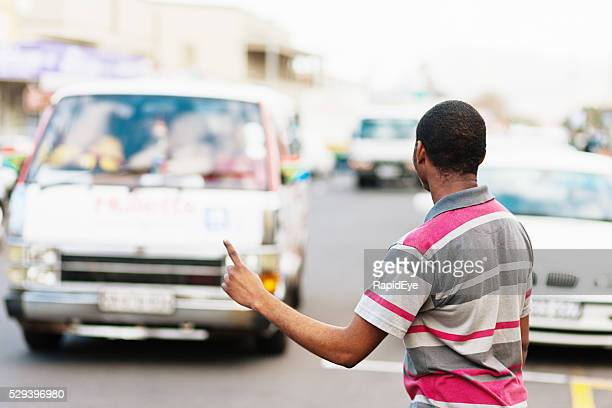 Cape Town man  showing required destination, hailing minibus taxi
