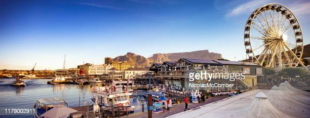 cape town panoramic view of victoria and albert waterfront with table mountain - cape town stock pictures, royalty-free photos & images