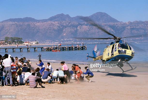 Cape Town police try to drive Black antiapartheid protesters off a Whitesonly beach with helicopter sand spray With the coming of a freer political...