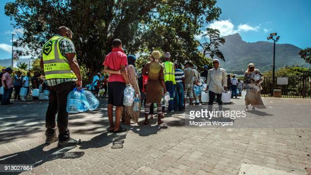 Cape Town residents queue to refill water bottles at Newlands Brewery Spring Water Point on January 30 2018 in Cape Town South Africa Diminishing...