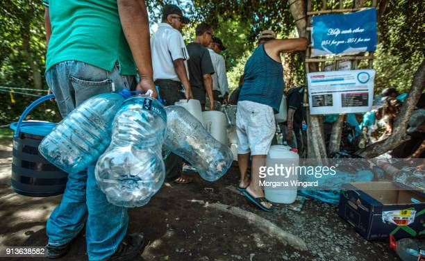 Cape Town residents queue to refill water bottles at Newlands Spring on January 31 2018 in Cape Town South Africa Diminishing water supplies may lead...