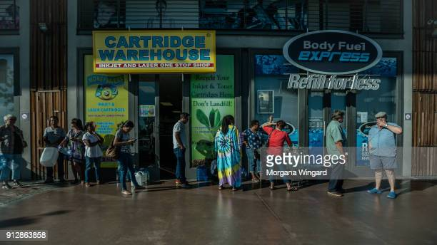 Cape Town residents wait in a queue to refill water bottles on January 30 2018 in Cape Town South Africa Diminishing water supplies may lead to the...