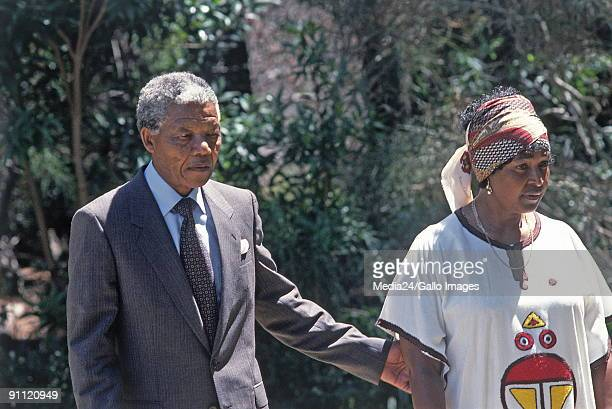 Cape Town South Africa ANC president Nelson Mandela strolling in the garden of Archbishop Desmond Tutu's home in Bishopscourt with his wife Winnie...