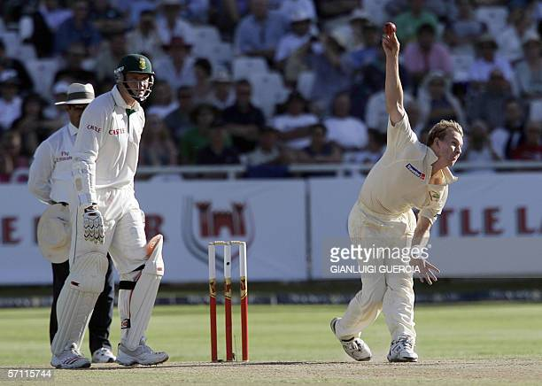 Australian bowler Brett Lee delivers a ball watched by South African batsman and captain Graeme Smith during the day two of the first test at...