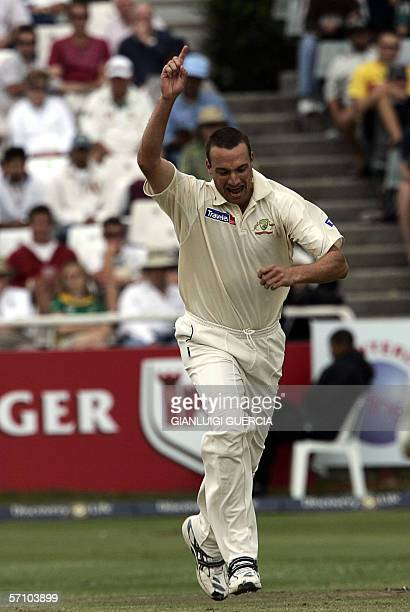 Australian bowler Stuart Clark celebrates the dismissal of South African batsman and Captain Graeme Smith 16 March 2006 during the day one of the...