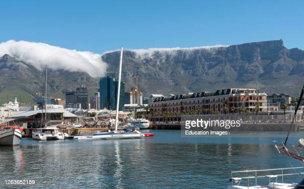 Cape Town, South Africa, Landscape view of the waterfront and cloud creeping over the summit of Table Mountain.