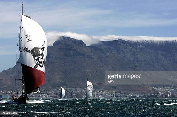 Pirates of the Caribbean from USA ABN Amro two from The Netherlands and Movistar from Spain race 26 December 2005 in the Cape Town harbour race as...