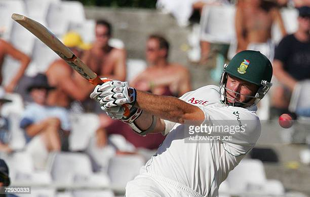 South African opening batsman Graeme Smith plays a shot off India's Shanthakumaran Sreesanth during South Africa's 2nd innings on the 4th Day of the...