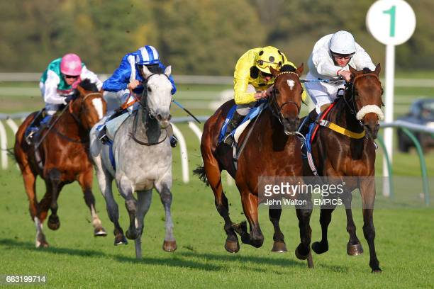 Cape Tribulation ridden by jockey Tom Evans moves in to the lead during The racinguktv Maiden Stakes