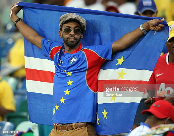 Cape Verde fan holds a flag aloft during the 2013 African Cup of Nations match between Morocco and Cape Verde at Moses Mahbida Stadium on January 23...
