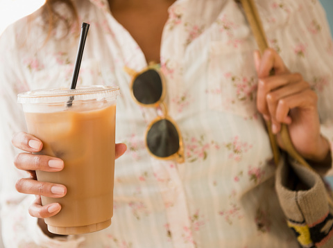Cape Verdean woman drinking iced coffee - gettyimageskorea