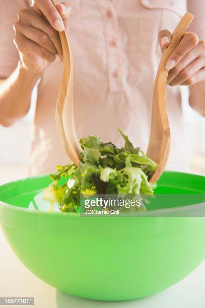 Cape Verdean woman tossing a salad