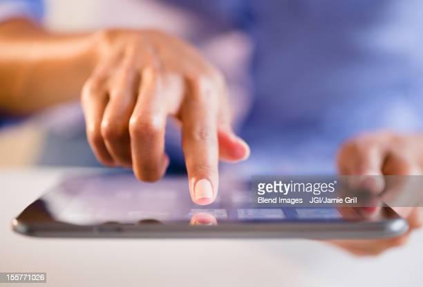 Cape Verdean woman using digital tablet