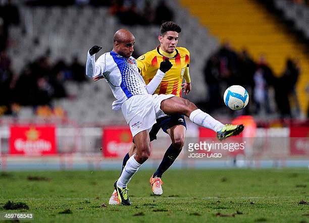 Cape Verde's defender Nivaldo Santos 'Tax' vies with Catalonia's defender Marc Bartra during the friendly football match Catalonia national team vs...