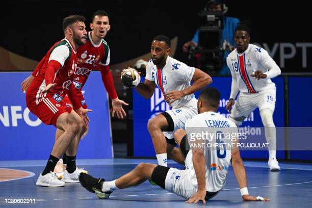 Cape Verde's left back Edmilson Araujo is challenged by Hungary's wing Stefan Sunajko during the 2021 World Men's Handball Championship between Group...