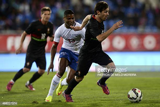 Cape Verde's midfielder Platini vies with Portugal's midfielder Bernardo Silva during the EURO 2016 friendly football match Portugal vs Cape Verde at...