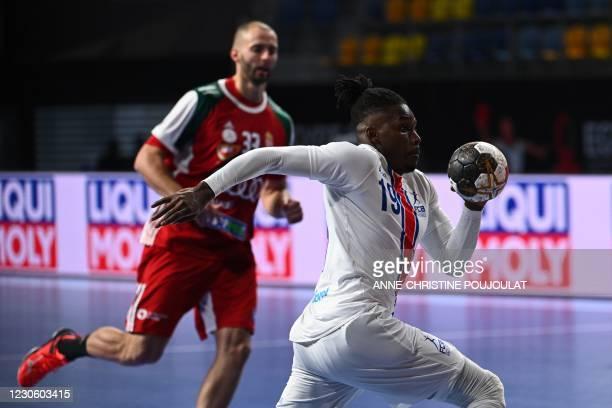 Cape Verde's right winger Admilson Estaliny Furtado runs with te ball during the 2021 World Men's Handball Championship between Group A teams Hungary...