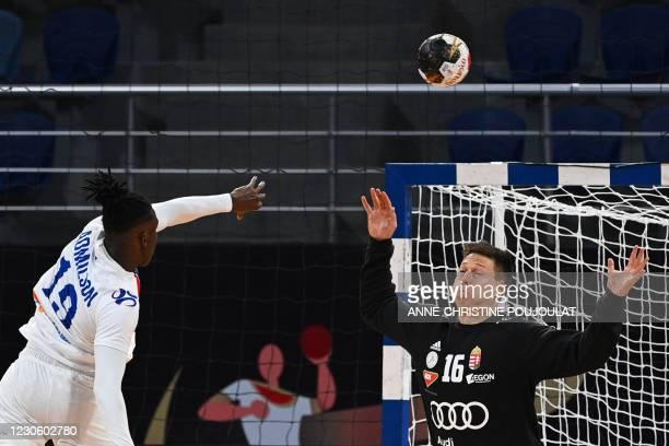 Cape Verde's right winger Admilson Estaliny Furtado shoots at Hungary's goalkeeper Roland Mikler during the 2021 World Men's Handball Championship...
