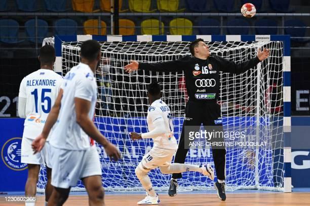 Cape Verde's right winger Admilson Estaliny Furtado shoots past Hungary's goalkeeper Roland Mikler during the 2021 World Men's Handball Championship...