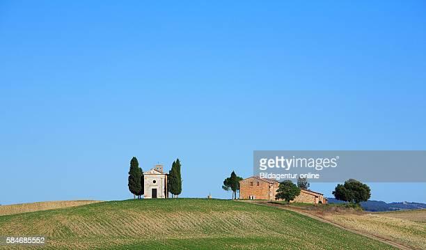 Capella Tu Vitaleta with San Quirico of d' Orcia Crete Tuscany Italy / church capella Tu Vitaleta near San Quirico d'Orcia Crete Tuscany Italy