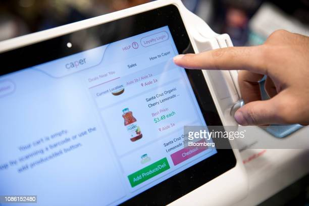 A Caper Inc smart shopping cart monitor displays items for sale at a Foodcellar Co grocery store in the Long Island City neighborhood in the Queens...