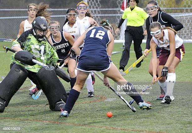 Cape's goalie Julianne Ayers sets to block a shot from Yarmouth's Hannah Peters as Cape Elizabeth field hockey hosts Yarmouth at Hannaford Field in...