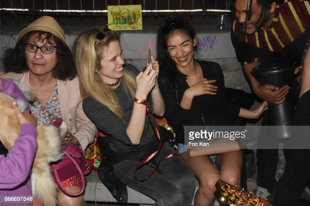 Caphi Julie Jardon and Sabrina Sebti attend Photographer Ko Kok Birthday Party At Le Vert Galant Garden on April 9 2017 in Paris France