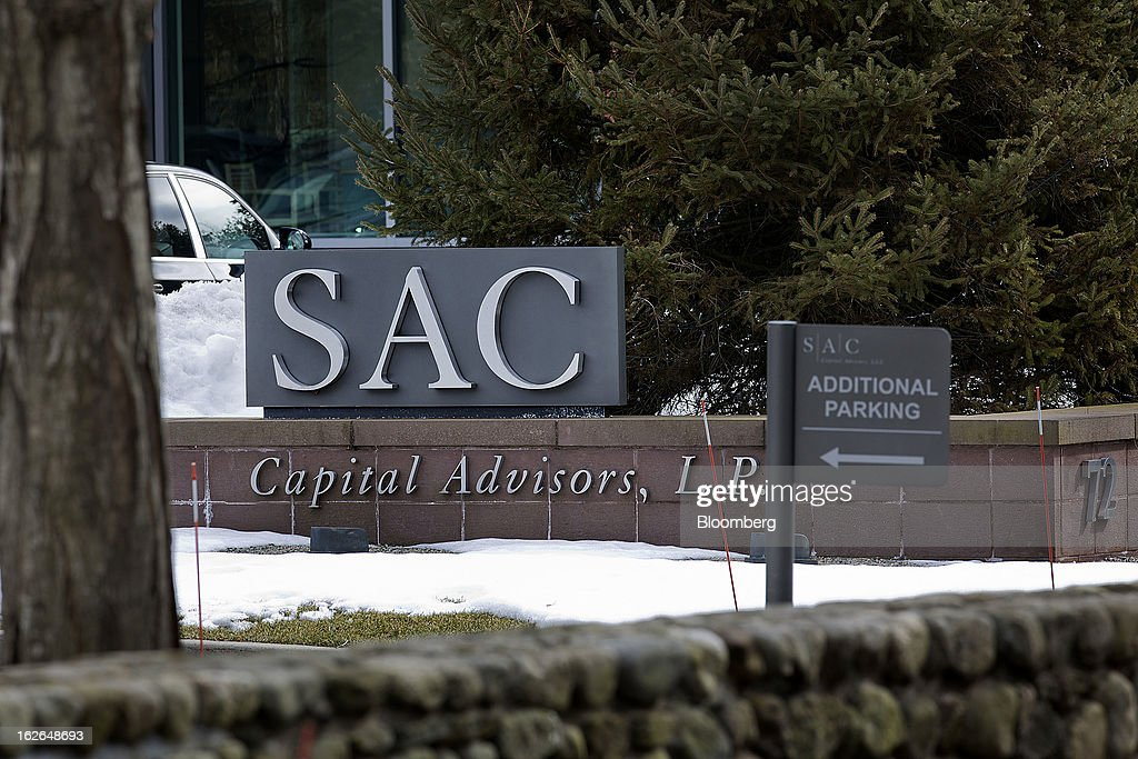 SAC Capital Advisors LP signage stands outside the company's headquarters in Stamford, Connecticut, U.S., on Friday, Feb. 22, 2013. U.S. investigators have subpoenaed a 2011 deposition of SAC Capital Advisors LP founder Steven Cohen, whose sworn statements on insider-trading compliance may hurt him as he tries to persuade regulators not to file a lawsuit with the potential to shut his $14 billion firm. Photographer: Victor J. Blue/Bloomberg via Getty Images