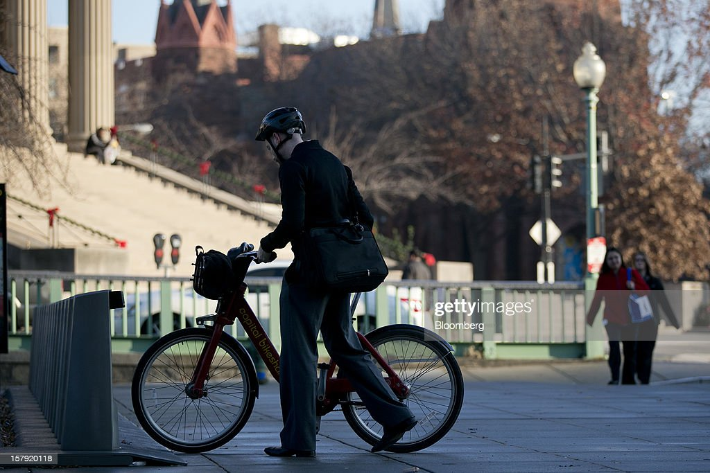 A Capital Bikeshare bicyclist checks out a bike from a docking station in Washington, D.C., U.S., on Monday, Dec. 3, 2012. Since Sept. 2010, Capital Bikeshare has dispersed more than 1700 bikes for rent across the city and has totaled over 3.5 million rides since Sept. 2011. Alta Bicycle Share, the company that was awarded the contract to run the program, has installed 191 solar-powered docking stations throughout the District and Arlington, Virginia. Photographer: Andrew Harrer/Bloomberg via Getty Images