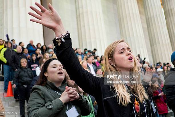 Capital Church volunteer Hailey Graven of Christiansburg Va raises her hand and sings with thousands of Christian faithful to celebrate the...